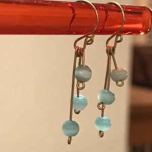 Jewelry - Silver dangle earring with blue bead accent.